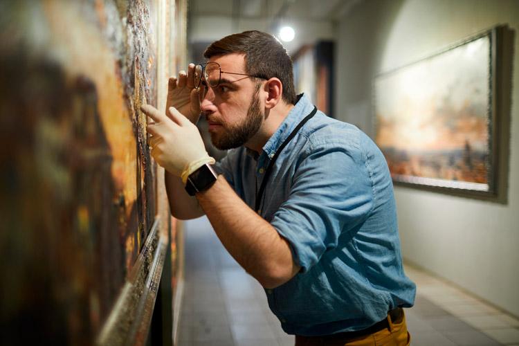 Man inspecting an art piece