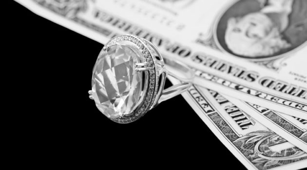 Diamond ring and dollar banknotes