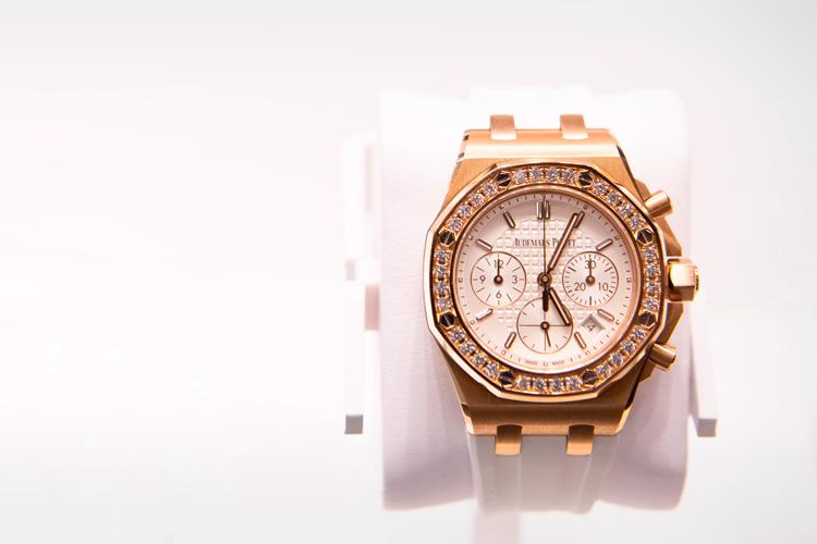 Audemars Piguet gold Royal Oak luxury watch on white background